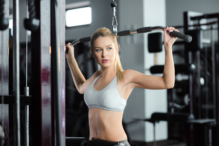 bra top: girl in great shape in the gym Stock Photo