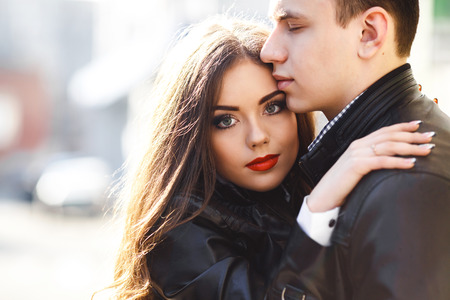 tenderly: beautiful young couple tenderly embracing each other
