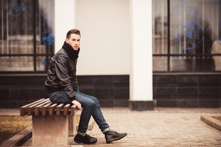casual clothing: Fashion male model on the bench  Stock Photo