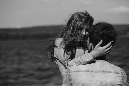 two girls hugging: beautiful couple having fun on the lake