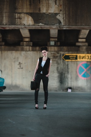 parking spaces: beautiful girl posing with a case of parking spaces