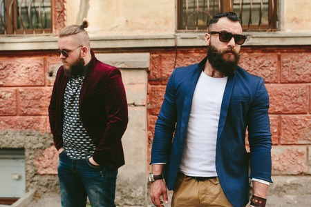three day beard: Two stylish bearded men on the background of the old town