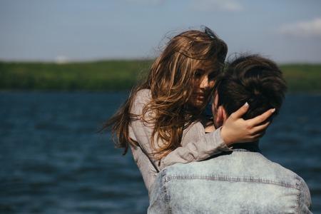 beautiful couple having fun on the lake