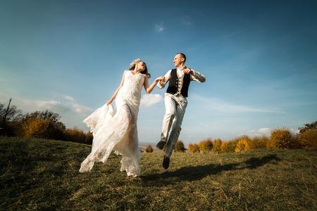 beautiful couple having fun on the lawn