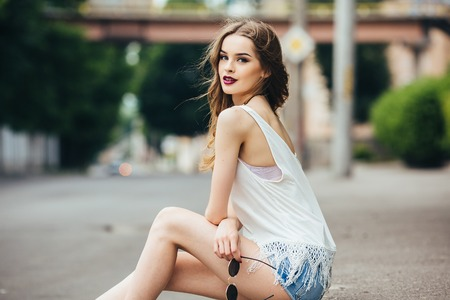 beautiful girl posing in the city on the street