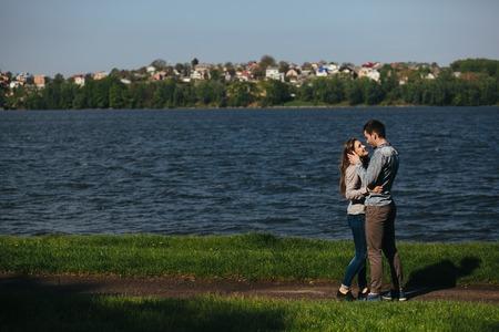 loving couples: beautiful couple having fun on the lake