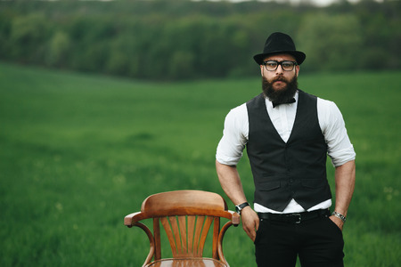greem: Man with a beard and sunglasses in the green field
