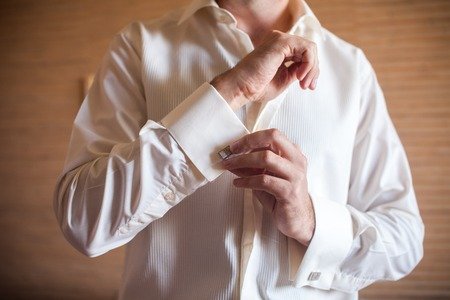 cuffs: Groom preparing for the morning of the wedding ceremony