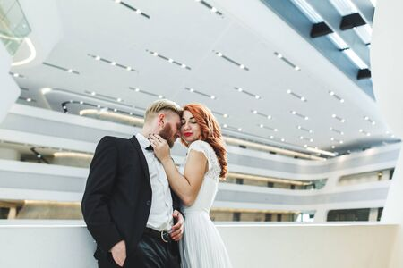 futuristic building: Lovely bride and groom in a futuristic building Stock Photo
