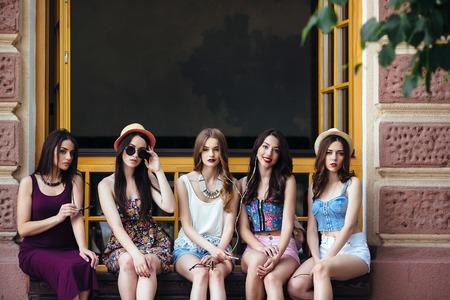 camra: Five beautiful young girls relaxing in the city