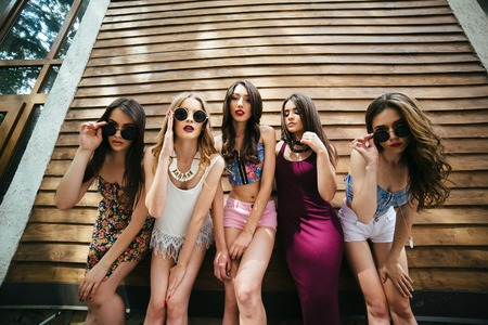 camra: Five young beautiful girls on the street looking at the camera Stock Photo