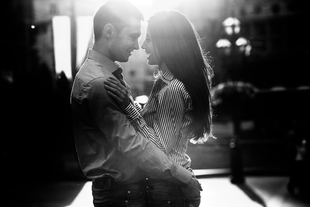 love life: young beautiful couple together posing against the backdrop of the old town