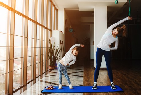 family indoors: Charming family spends time in the gym