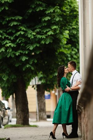 romantic man: Photo beautiful couple kissing on the street Stock Photo