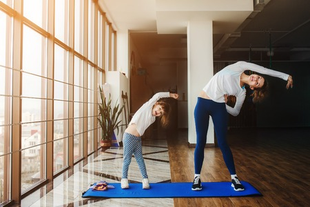 child sport: Charming family spends time in the gym