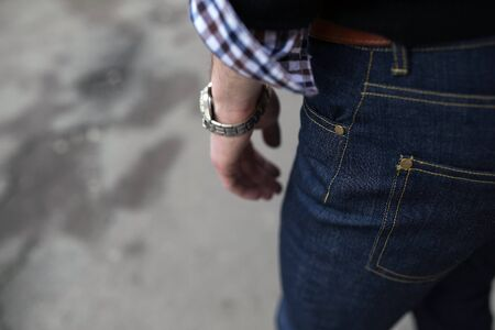 british ethnicity: Confident man posing in selvedge  jeans. A man dressed in jeans, a close-up shot