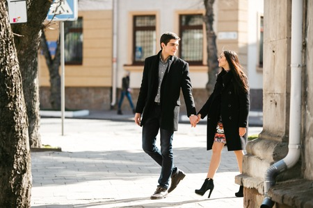 street love: beautiful young couple meets against the backdrop of the city