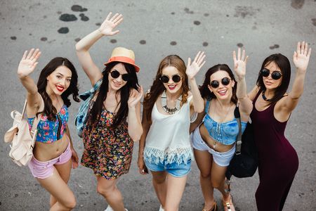 Five young beautiful girls having fun outdoors