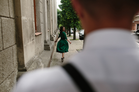summer dress: Photo of the girl made from behind Man Stock Photo