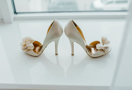 wedding accessories: White pair of shoes on the table.
