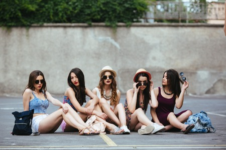 pretty young girl: Five beautiful young girls relaxing in the city