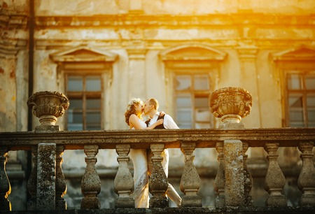 beautiful couple posing on a background of the old castle