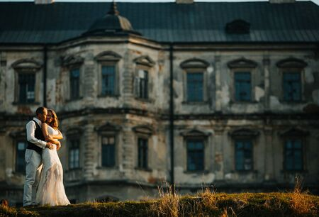 castle: beautiful couple posing on a background of the old castle