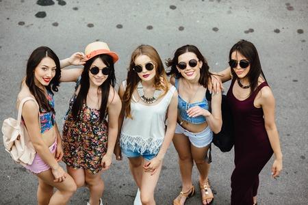 color: Five young beautiful girls having fun outdoors