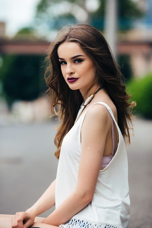 casual fashion: beautiful girl posing in the city on the street