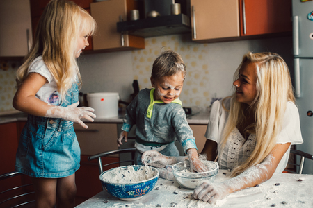 work from home: Mother with family haveing fun in the kitchen Stock Photo