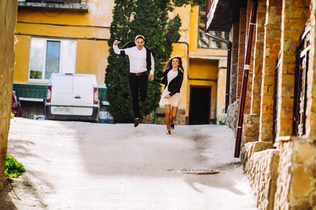 hot colors: beautiful couple having fun in the old town Stock Photo