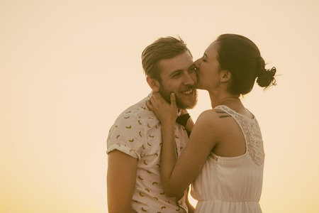 love life: beautiful couple together watching a beautiful sunset Stock Photo