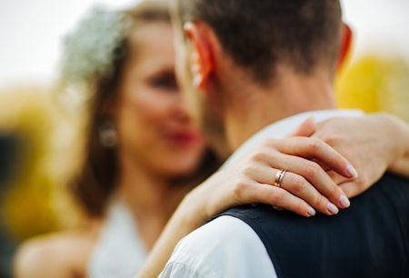 tenderly: beautiful couple enjoying embrace of each other and tenderly smiling Stock Photo