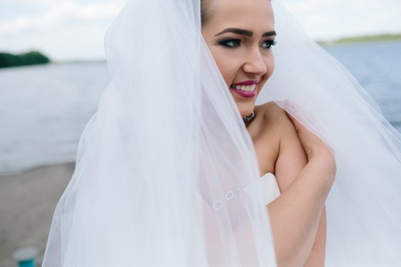 wedding dress: Portrait of pretty bride pictured in traditional white wedding dress.