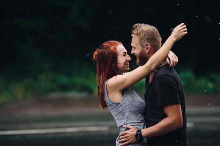 beautiful couple: beautiful couple hugging on outside in the rain