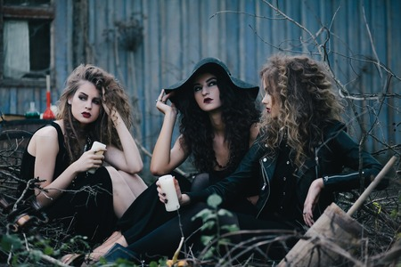 Three vintage witches gathered for the Sabbat eve of Halloween Stock Photo