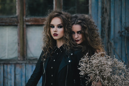 mystic place: Two vintage witches gathered for the sabbat eve of Halloween