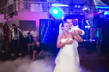 beautiful bride and groom dancing the first dance