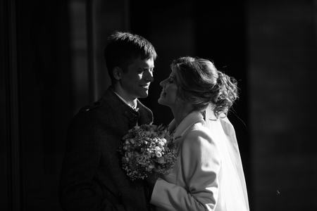 tenderly: bride and groom tenderly looking at each other Stock Photo