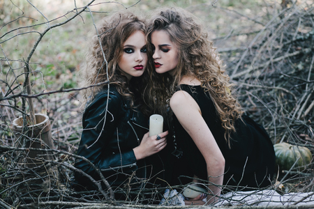 Two vintage witches gathered for the sabbat eve of Halloween Stock Photo - 47780402