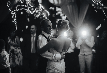 wedding dance of beautiful young newlywed couple 스톡 콘텐츠