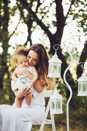 mother and daughter together in garden outdoors Banque d'images