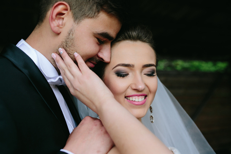 close in: beautiful couple hugging outdoors in wooden hut, a close angle