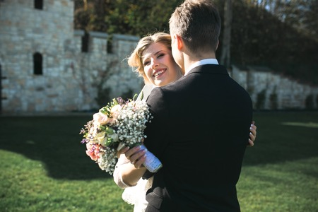 wedding couple: Bride and groom having fun in an old town