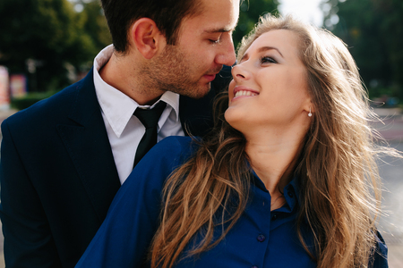 guy hugging his girlfriend from behind in the city