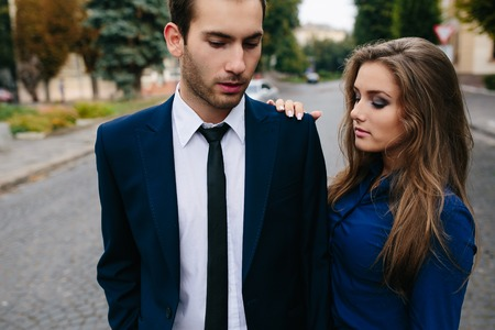 stylish couple: man and woman walking together on the street Stock Photo