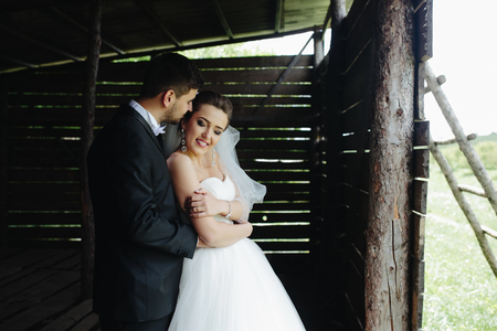 wooden hut: beautiful couple hugging outdoors in wooden hut