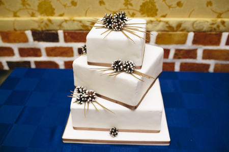 square-shaped wedding cake is on the table