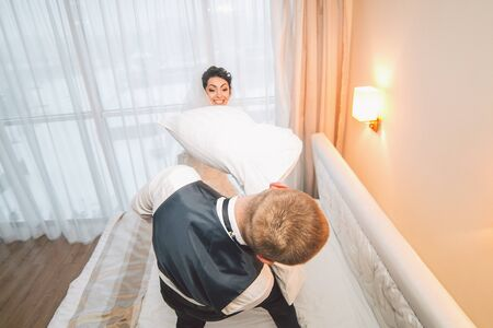 hotel: Bride and groom in a hotel room Stock Photo