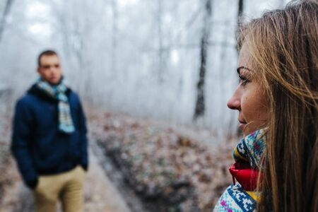 2 people: man and woman walking together on winter park